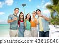 friends taking selfie by monopod over beach 43619040