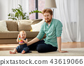 father playing with little baby daughter at home 43619066