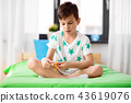 happy little boy playing with airplane toy at home 43619076