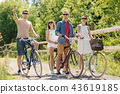 happy friends riding fixed gear bicycles in summer 43619185