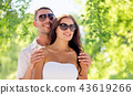 happy couple hugging over green natural background 43619266