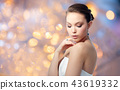 beautiful woman with earring and finger ring 43619332