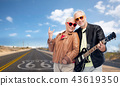 senior couple with electric guitar over route 66 43619350
