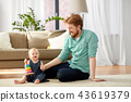 father playing with little baby daughter at home 43619379
