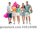 happy friends with beach and summer accessories 43619488
