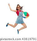 teenage girl in sunglasses jumping with beach ball 43619791