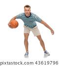 smiling young man dribbling basketball 43619796