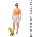 smiling teenage girl with skateboard over white 43619801