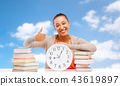 student with books and clock showing thumbs up 43619897