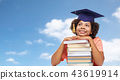 close up of african graduate student with books 43619914