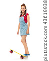 smiling teenage girl with skateboard over white 43619938