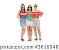 happy female friends with sale banner 43619948