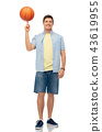 smiling young man spinning ball on finger 43619955
