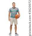 smiling young man with basketball 43620072