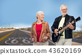 senior couple with electric guitar over route 66 43620169