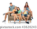 friends with tablet pc and smartphones sit on sofa 43620243