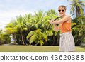 happy teenage girl with racket playing tennis 43620388