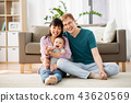 happy family with baby boy at home 43620569