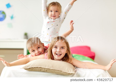 happy little kids having fun in bed at home 43620717