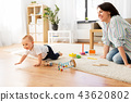 happy mother with little baby boy playing at home 43620802