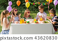 happy kids with cake on birthday party at summer 43620830
