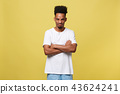Human facial expressions, emotions and feelings. Portrait of mad angry young dark-skinned male 43624241