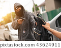 Men thiefs stealing young woman 43624911