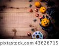 Happy Halloween. Werewolf hands painting pumpkin 43626715