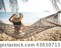 Happy woman relaxing in hammock 43630713