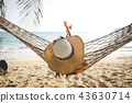 Happy woman relaxing in hammock 43630714