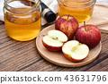 Apple cider vinegar on wooden board, Kombucha. 43631796