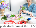young women business owner florist making or Arranging Artificia 43636377