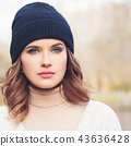 Young woman face closeup. Autumn woman  43636428