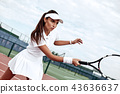 Tennis player playing on the court on a sunny day 43636637