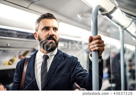 A portrait of a serious hipster businessman travelling by subway. 43637226