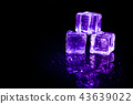 Purple ice cubes reflection on black table. 43639022