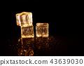 Golden ice cubes on black background. 43639030