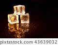 Golden ice cubes on black background. 43639032