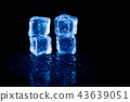 Blue ice cubes reflection on black table. 43639051