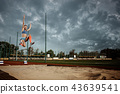 Female athlete performing a long jump during a competition 43639541