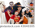 family celebrating Halloween 43640305