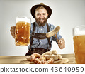 Germany, Bavaria, Upper Bavaria, man with beer dressed in traditional Austrian or Bavarian costume 43640959