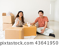 Happy couple eat noodle on carboard box at new house 43641950
