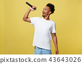 young handsome african american boy singing opera emotional with microphone. 43643026