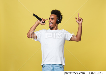 young handsome african american boy singing opera emotional with microphone. 43643045