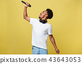 young handsome african american boy singing opera emotional with microphone. 43643053