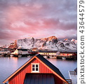 Houses in the Lofoten islands bay during sunrise. 43644579