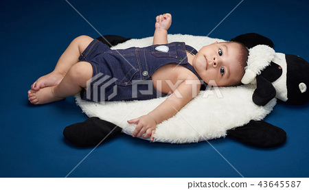 Baby in costume lay on pillow 43645587