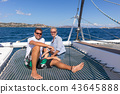 Romantic couple relaxing on a summer sailin cruise, sitting on a luxury catamaran, sailing in 43645888