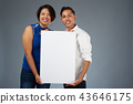 Couple hold white banner 43646175